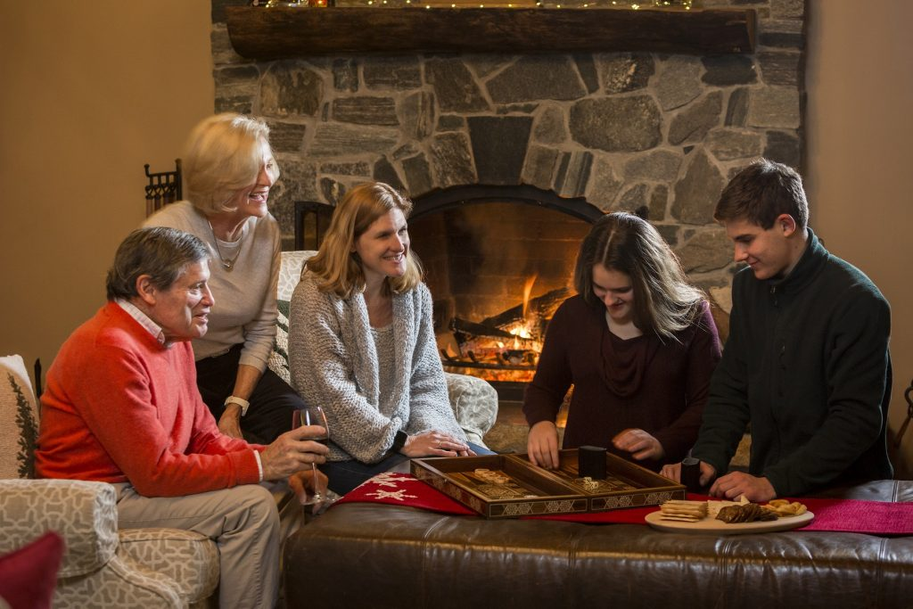 family playing games in seesaws lodge