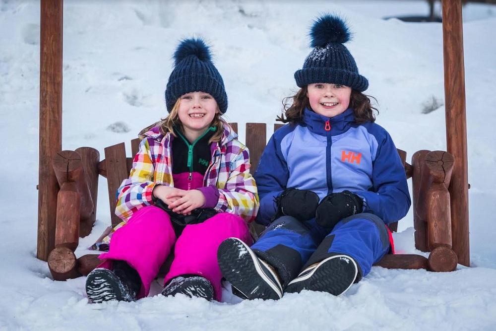 girls on swing in winter